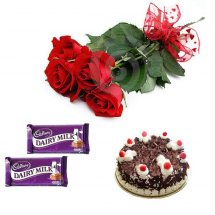 2 Dairy Milk chocolates 4 Red Roses 1/2 Kg Black forest Cake