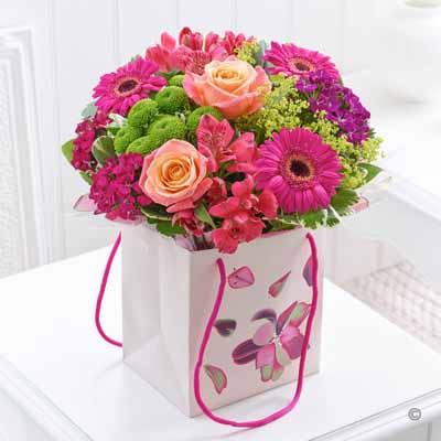 Fresh flowers in a gift bag
