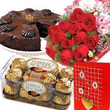 Flowers and chocolates with cake and rakhi