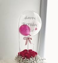 15 Red roses basket with single pink air balloon inside a Printed Happy Birthday transparent Balloon