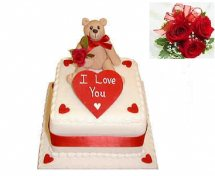 Teddy on cake with icing i love you and 5 roses free