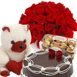 24 Red roses, 6 inch Teddy, 16 chocolates ferrero and 1/2 kg cake