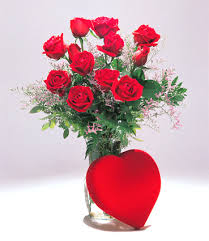 12 red roses in a vase with valentine heart